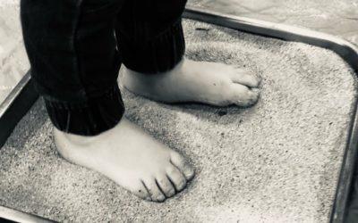Les pieds dans le sable